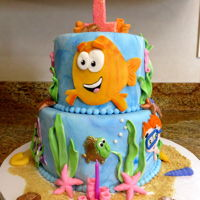 "Bubble Guppies   Two tier cake with fondant decorations and gumpaste number ""1"""