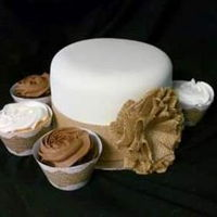 Burlap Wedding Cake/cupcakes White Chocolate wedding cake with Vanilla and Chocolate cupcakes.