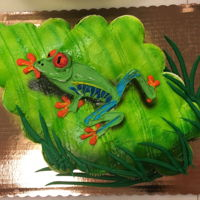 Buttercream Frog On A 24 Ct Cupcake Cake 24 cupcakes, decorated with buttercream and airbrushed with a buttercream piped tree frog on top