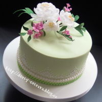 Cake With Edible Lace   White flowers are made from wafer paper.