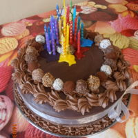 "Candle Cake 12"" choc fudge cake with nutella smbc filling, choc ganache and glace icing dribbles."