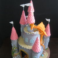 Castle With Dragon  Two Tier Round Cakes with Castle Designs and Dragon. Turrets on castle were made and covered with fondant. Dragon was hand created in...