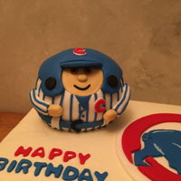 Cubs Birthday Buttercream covered cake, Cubs theme, round Cubs guy designed from a toy and is also cake