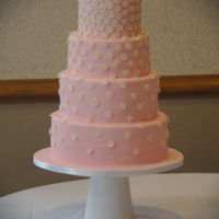 Daisy Cascade Wedding Cake  Four tier wedding cake covered with pink sugarpaste and decorated with hundreds of sugarpaste daisies. Cake flavours - double chocolate,...