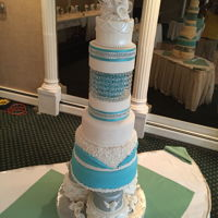 Davis-Philips Wedding Cake 2016 French vanilla cake, chocolate fudge cake with vanilla and chocolate buttercream frosting. All decorations are fondant except the bling...