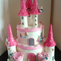 Fairytale Princess Castle Two tiered pink and white castle with Disney Princess butterflies