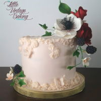 Floral Bas Relief Cake A peachy bas relief cake adorned with sugar roses, anemones, blossoms and blackberries.
