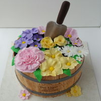 Flower Cake   Barrel of flowers for a retirement cake. All fondant flowers. Chocolate cake with almond buttercream covered with mmf.