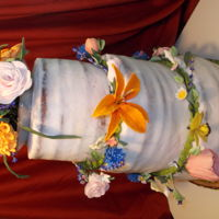 Garden Wedding Cake Carrot cake with skim coat cream cheese icing and gum paste flowers