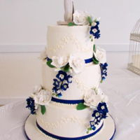 Gardenia Wedding Italian buttercream wedding cake with sugar gardenias and sugar delphiniums.