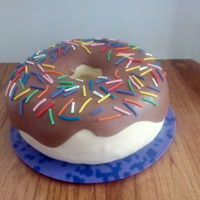 Giant Donut. Giant donut with chocolate icing and sprinkles.