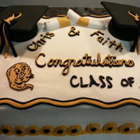 Graduation Cake Fondant mortar boards decorate this cake for a graduating couple.