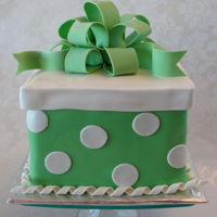 Green Polka-Dotted Gift Cake   Six inch square cake covered in fondant with fondant bow.