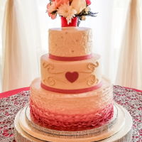 Hearts And Ruffles Buttercream cake with fondant accents
