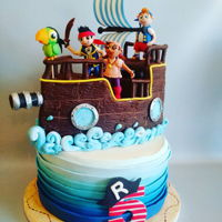 Jake And The Neverland Pirates Bottom layer is fondant. Ship is cake with a couple of cereal treat squares. Ship is covered with modeling chocolate. Figures, sail and #5...
