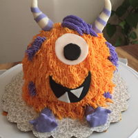 Lil Monster   Smash cake, frosted in furry BC with fondant accents