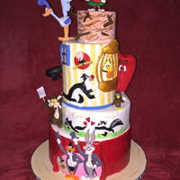 Looney Tunes! I made this for a huge Looney Tunes fan! I think it was the most fun I ever had making a cake! TFL!!