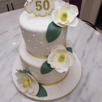 Magnolia Anniversary Cake An anniversary cake with quilting details and sugar magnolias