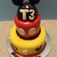 Mickey Mouse   Vanilla cake with marshmallow buttercream and fondant decorations.