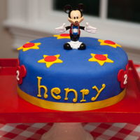 Mickey Mouse Birthday Cake Vanilla cake with almond buttercream and covered in blue fondant
