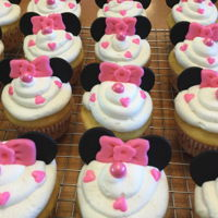Miss Minnie Cake And Cupcakes   Marble cake with vanilla cream filling. Cupcakes are vanilla. All the accents are done in MMF