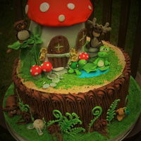 "Mushroom House & Tree Stump Cake Mushroom cake house, even put lights in the window and door. The 12"" cake was decorated to look like a stump, with woodland creatures..."