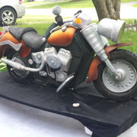 My Motorcycle Cake The motorcycle has remote controlled lights, the seat and tires are made from dark chocolate modeling clay and the front wheel section...
