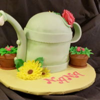 "Nana Loves Her Gardening Vanilla Cake - Buttercream Iced and Marshmallow fondant. 6"" Cake Pans, Small Sports Ball pan. The pots are made from the cake cut off..."