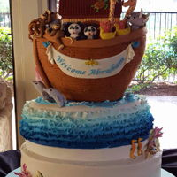 Noah's Ark Baby Shower Cake  Noah's Ark 3-tier oval shaped vanilla cake with raspberry filling, SMBC, fondant covered, filled with modeling paste elephants, rhinos...