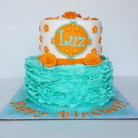 Orange & Aqua Ruffle Birthday Cake Ruffle cakes never get old! Top tier is pink lemonade cake with pink lemonade buttercream. Bottom tier is chocolate cake with almond...