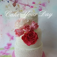 Peony Wedding Cake. Wedding cake with sugar peony roses and edible lace.