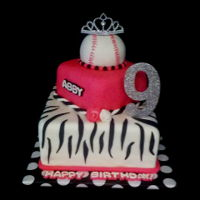 Pink And White Baseball Cake For a little girl turning 9, she couldn't whether to go with baseball or princess so we did both.