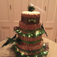 Pirouline Cake Green and brown holiday themed party for office. Vanilla and chocolate cake with buttercream frosting all surrounded in various types of...