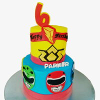 Power Rangers Power rangers cakes with fondant faces on the bottom tier.