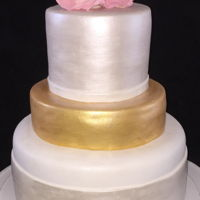 Pretty Golden Anniversary   With gum paste flowers pearl dust and gold dust. TFL!!