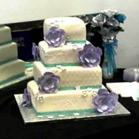 Purple And Teal Wedding Cake White chocolate with vanilla Buttercream and vanilla fondant. Gumpaste flowers and royal icing template.