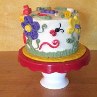 Quilling! Fondant quills on a buttercream cake. Marbled strawberry and butter yellow cake.