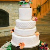 Quilted Wedding Cake 5 tiers of wedding cake! Quilted tiers, bling, fresh flowers, who could ask for more!