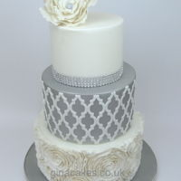 Silver & White Wedding Cake With Contrasting Onlay And Diamantes Silver & White wedding cake with contrasting morrocan style onlay and diamantes