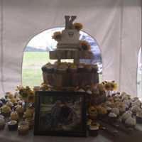 Sunflower Wedding   Rustic wedding cake and cupcakes, with fondant sunflowers. Frosted in BC and marshmallow cream.