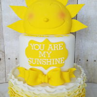 Sunshine You are my sunshine themed cake with ombre ruffles. Rkt for the sun.