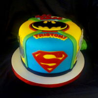 Super Heroes Cake Red Velvet Cake with all you favorite super heroes. Took me all night but I love how it turned out.