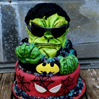 Super Hero's The client gave me free reign to design this cake. I don't have much experience in the 3-d sculpting but I am getting better.