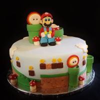 "Super Mario Cake 10"" M&M confetti cake with fondant Mario figure and accessory pieces."