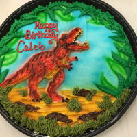 "T. Rex On A 12"" Round Cookie Cake Buttercream T. rex on a cookie cake."