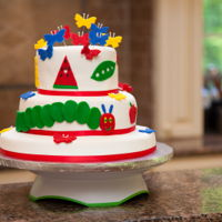The Very Hungry Caterpillar Three tier vanilla cake filled with vanilla buttercream covered with white and primary color fondant
