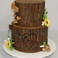 Tree Stump Wedding Cake This tree stump effect cake was made for a wedding this weekend with the bride and grooms initials carved into the tree. The top tier is a...