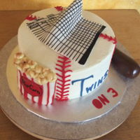 Twins On 3! Buttercream cake with fondant scorecard, popcorn box, and bat.