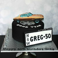 Tyre Cake With Monaro Car Topper Tyre cake with edible image Monaro topper and number plate display.