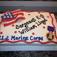 Veterans Day Cake Fondant flag and purple heart decorate this cake for one of our brave Veterans.